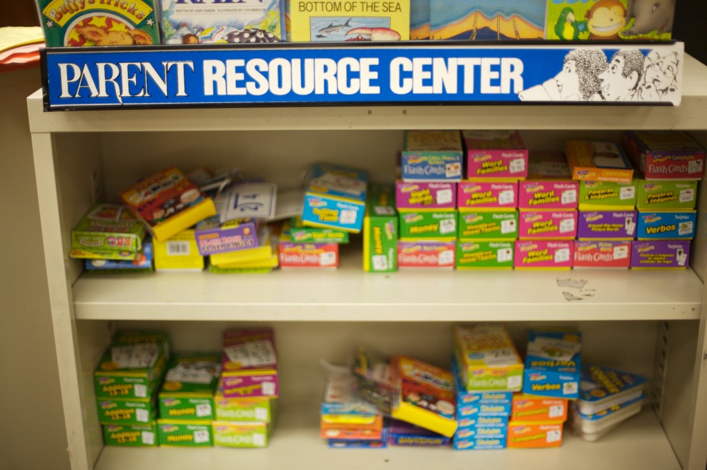 Parent Resource Center sign over shelves containing learning materials