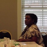 Tracy Barbers listens intently at a leadership council meeting