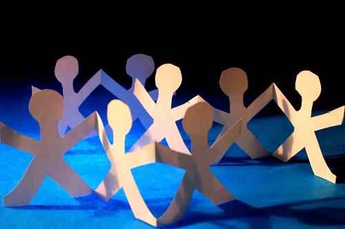 A chain of paper cutout people