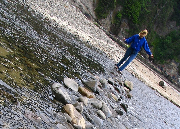 child crossing water on stepping stones