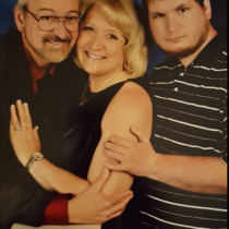 Teresa Johnson, her husband and one of her sons.