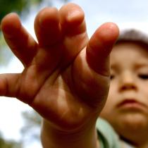 child reaching