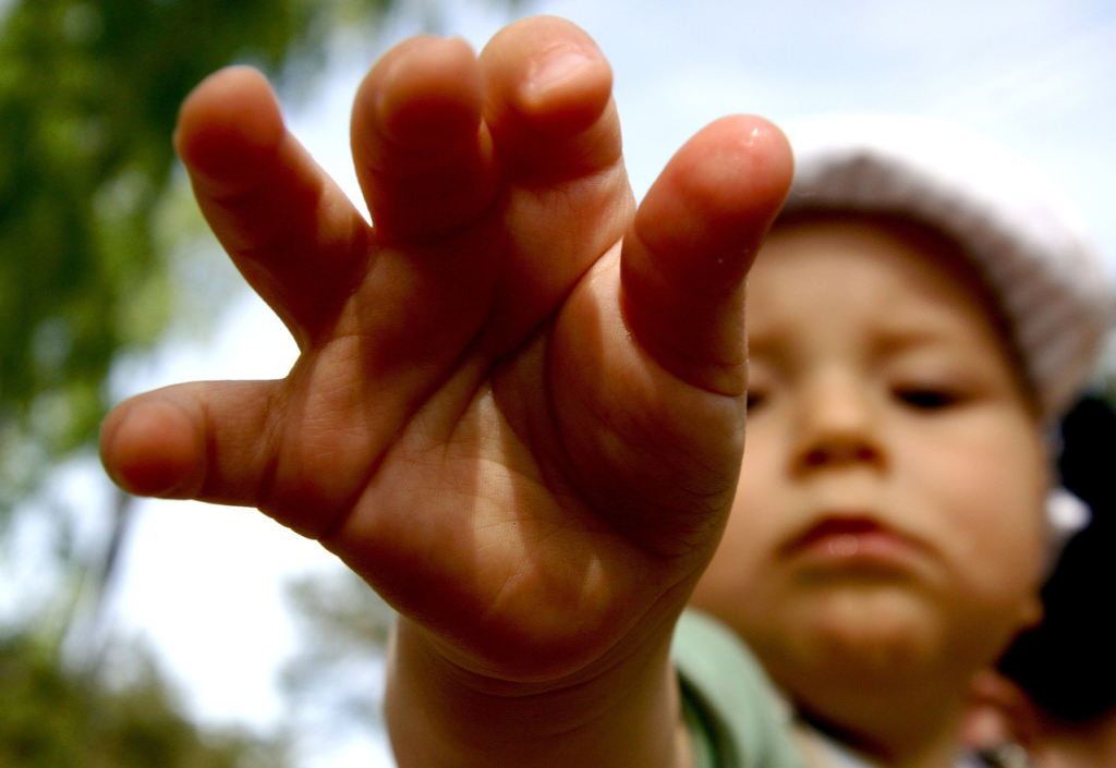Child reaching towards camera