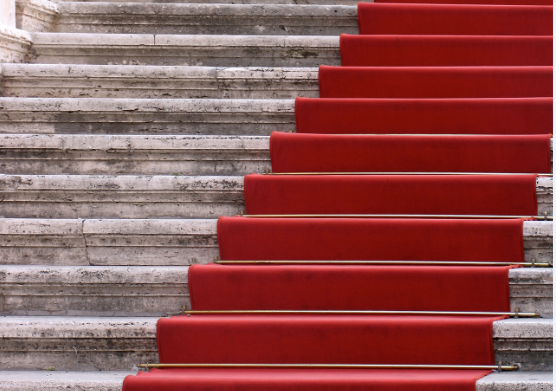Stairs draped with red carpet