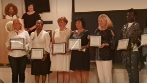 The 2018 nominees standing with certificates