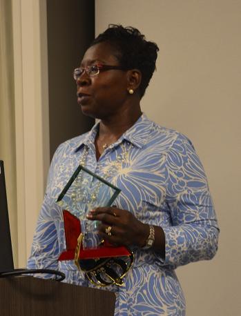 Shirley Daniels holding award