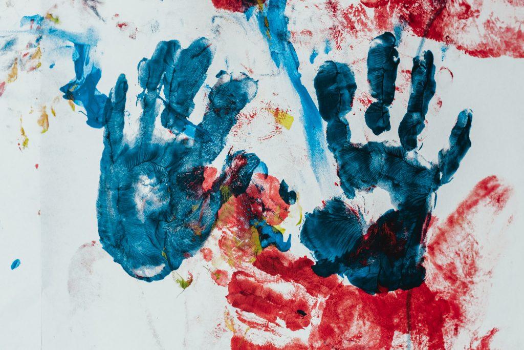 children's handprints made with fingerpaint